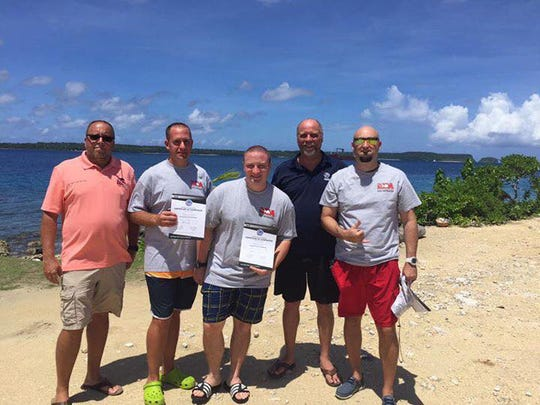 Congratulations to the most recent group of Micronesian Divers Association (MDA) PADI diving instructors.  They have a passion for scuba diving and have decided to teach scuba in order to share their love of the aquatic world with others.  Also in the photo is the PADI Regional Manager and MDA Course Director. Pictured, from left: Eric McClure (MDA Course Director), Tim Andrews, Joshua Kissel, Michael Janssen (PADI Regional Manager) and James Francis.
