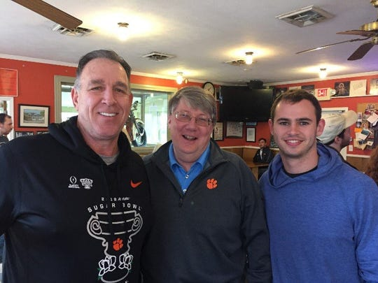 In another twist of fate, Tim Bourret (middle) ran into to Clemson football players Saturday who span his 40 years at Clemson --  Joe Bostic (left) and current standout Hunter Renfrow.