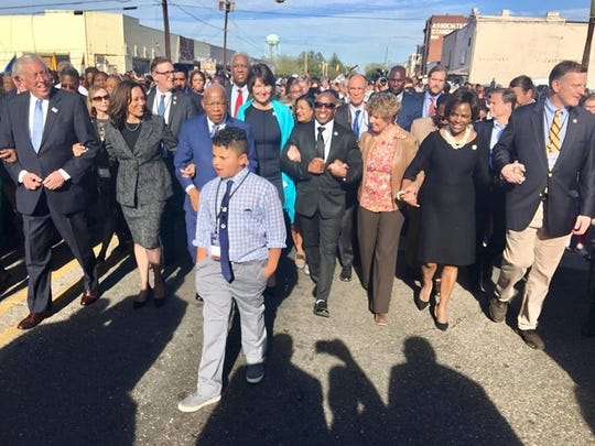 Tybre Faw, 10, of Tennessee, marches with Rep. John Lewis after meeting March 4 in Selma, Ala.