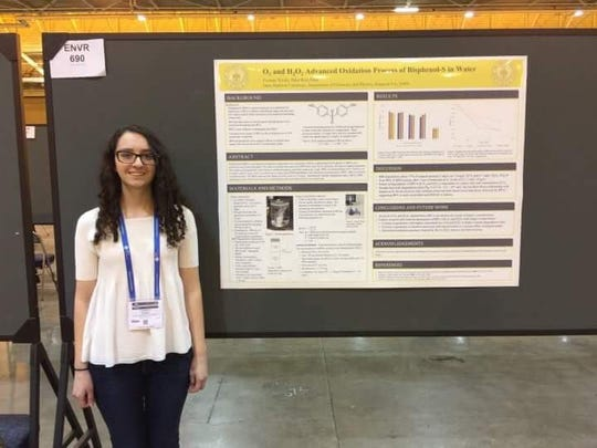 Corinne Weeks, 17, presents her research at the American
