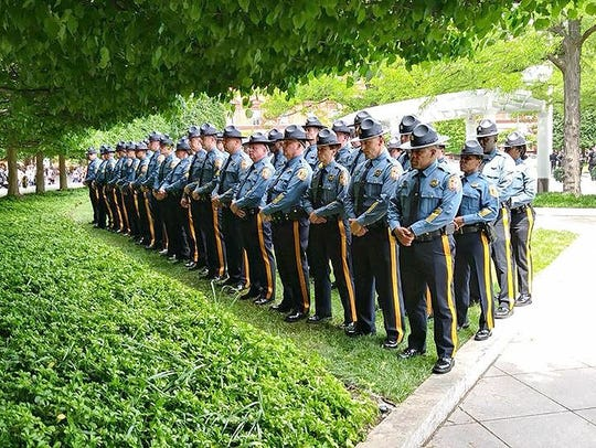 Members of the Delaware State Police, led by superintendent