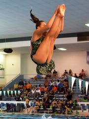 Novi diver Lorna Dunn makes the attempt against Northville.