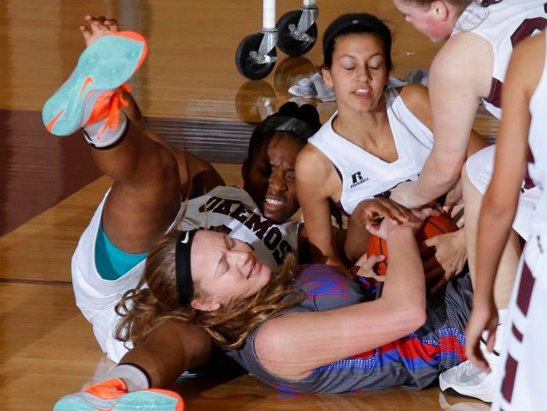 Mason's Autumn Kissman, bottom center, and Okemos' Oke Johnson, left, Melaina Grewal and Bergin Robinson, far right, battle for the ball Tuesday.