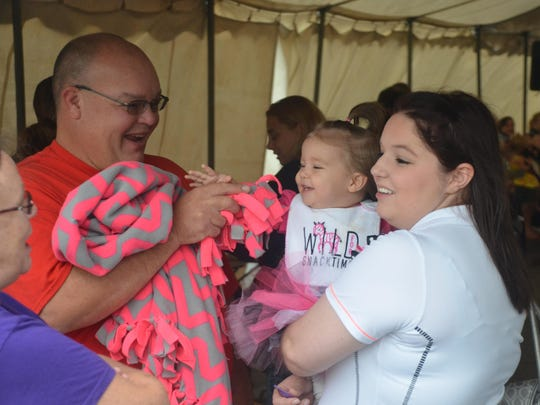 The Clyde Fair's Beautiful Baby contest continues this year. Paige Gower entered daughter Teagan into the 2015 contest as Grandpa Kevin Shetzer tried to get Teagan warmed up by making her smile.