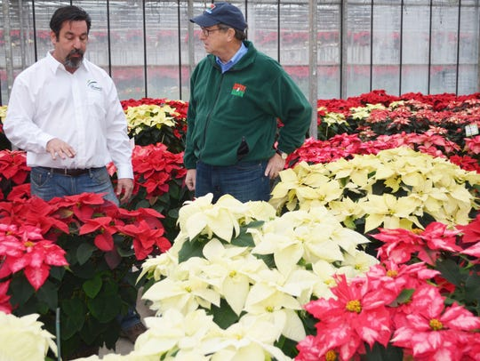Hionis Greenhouses co-owner Tim Hionis (left) and NJ