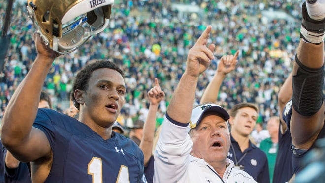 Sep 19, 2015; South Bend, IN, USA; Notre Dame Fighting Irish quarterback DeShone Kizer (14) and head coach Brian Kelly sing the Notre Dame Alma Mater after Notre Dame defeated the Georgia Tech Yellow Jackets 30-22 at Notre Dame Stadium. Mandatory Credit: Matt Cashore-USA TODAY Sports