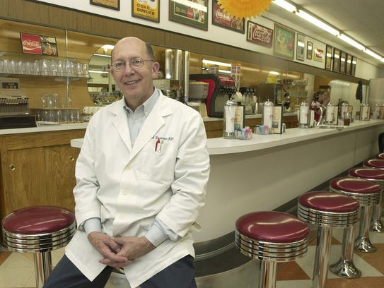 David Norman, at the time the owner of Ava Drug, sits