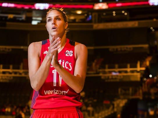Washington's Elena Delle Donne looks into the stands