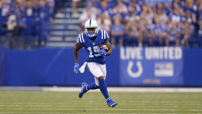 Indianapolis Colts wide receiver Phillip Dorsett (15) runs the ball into open field during the first half of an NFL football game Sunday, Sept. 25, 2016, at Lucas Oil Stadium.