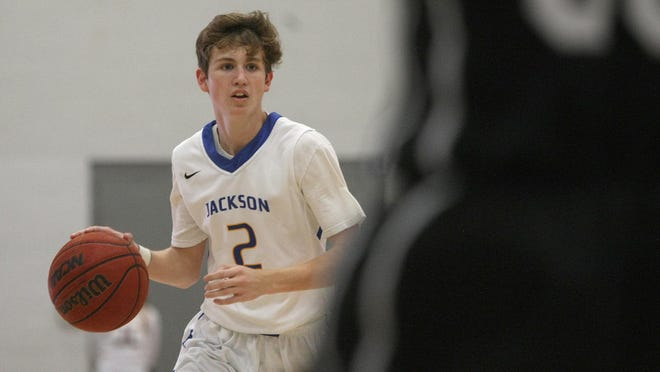 Jackson Christian's Logan Riddle (2) takes the ball down court against South Gibson at Jackson Christian on Friday.