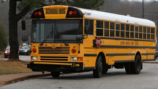 A bus drives up to North Parkway Middle School in Jackson, Tenn.