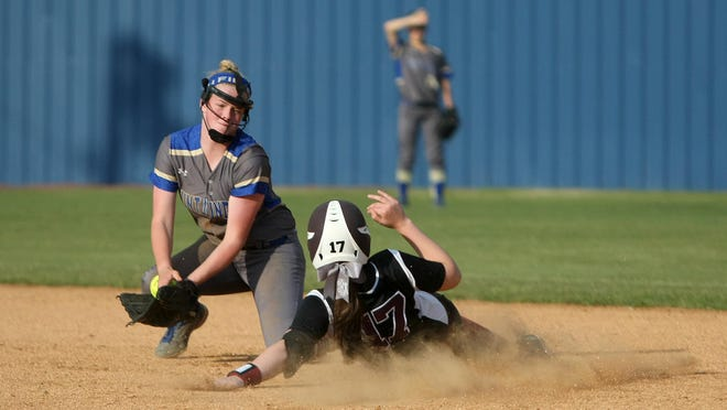 West Carroll's Shelby Browning (17) slides into second base against Huntingdon in the District 13-A championship last season.
