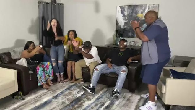 USC tackle Austin Jackson and family react when he was drafted by the Dolphins in the first round Thursday.