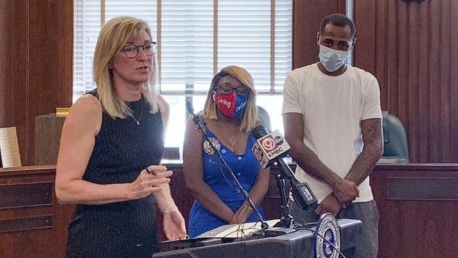 Jackson County Prosecutor Jean Peters Baker, left, announces charges Thursday against Ryson Ellis in the death of 4-year-old LeGend Taliferro while LeGend's parents Charron Powell, center, and Raphael Taliferro stood by. LeGend's death in June outraged the city and gave a name to a federal anti-crime initiative.