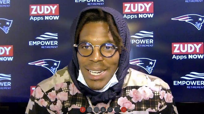 In this image from a Webex media availability, hosted by the New England Patriots, quarterback Cam Newton responds to a question on Friday.