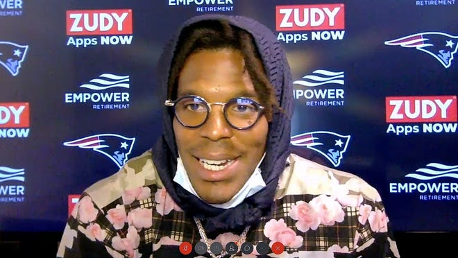 In this still image from a Webex media availability hosted by the Patriots, quarterback Cam Newton responds to a question on Friday.