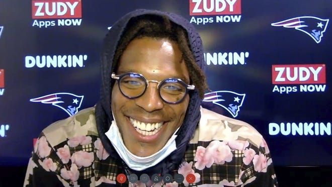 In this still image from a Webex media availability hosted by the New England Patriots, quarterback Cam Newton responds to a question Friday in Foxborough.