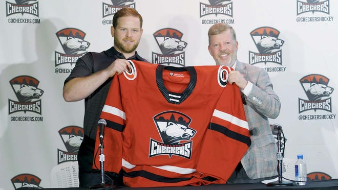 Marshfield native and former Cushing Academy Penguin hockey player Ryan Warsofsky (left) assumed the head coaching reins of the Carolina Hurricanes' AHL affiliate this past season, and navigated the Charlotte Checkers to a playoff spot before the coronavirus pandemic cut the season short.