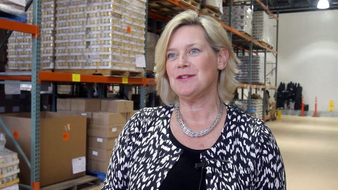 Ellen Lynch at the Food Bank for Westchester's warehouse in 2013.
