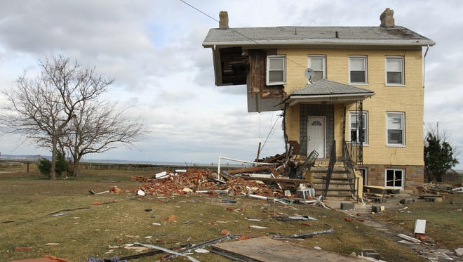 A Front Street home sheared in half in Union Beach in 2012.