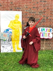 Nine-year-old Thomas D'Alessandro dresses up with the props made by the Gresham Middle School art club.