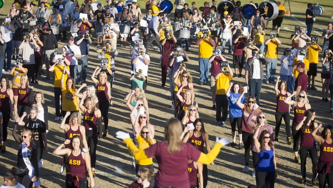 About 500 alumni coming from 28 states rehearse on Friday, Nov. 13, 2015, for ASU Sun Devil Marching Band's 100th anniversary this Saturday in Tempe.