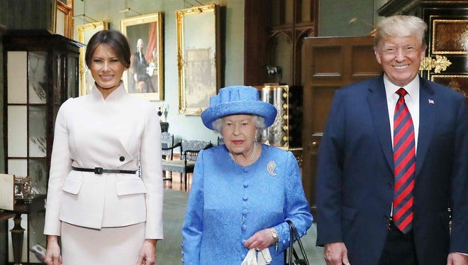 Queen Elizabeth II stands with President Donald Trump and first lady Melania Trump in the Grand Corridor at Windsor Castle in Windsor, July 13, 2018.