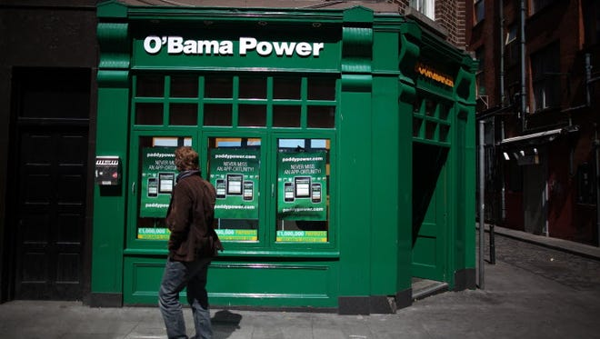 A Paddy Power bookmakers in Dublin undergoes a name change as former President Obama visits on May 23, 2001.