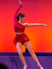 Emily Bencosme dances salsa during the talent portion