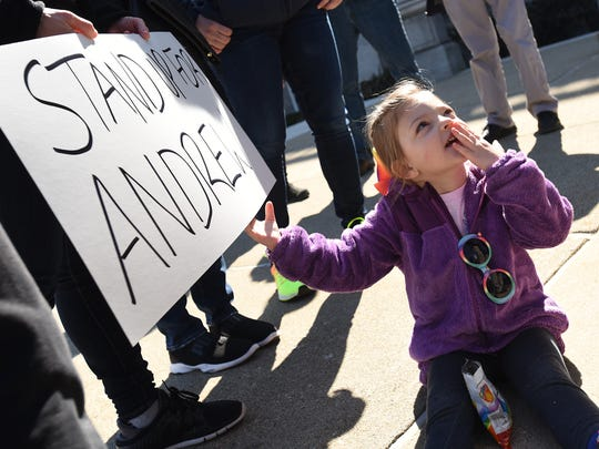 Ella Toro-Fuchs - 3 1/2 from Fair Lawn holds a sign in support of Andrew Kara at the rally. The Bergen County PBA Local 49 and the Gay Officers Action League rally outside the Bergen County Courthouse on Tuesday February 27, 2018 in support of Andrew Kara, a former county police officer who is now suing the sheriff, prosecutor and county over claims he was sexually harassed by other officers because he is gay.