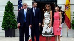 President Donald Trump poses with Spain's King Felipe