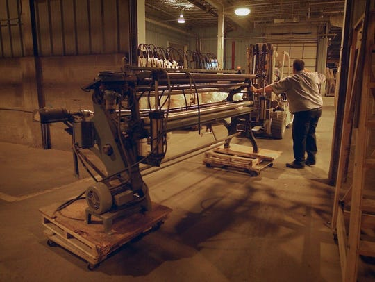A piece of woodworking machinery is moved into the