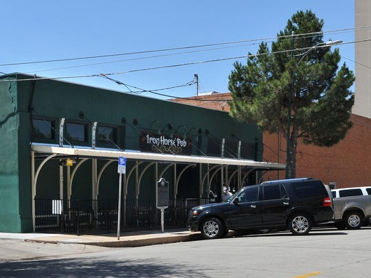 The Iron Horse Pub, located in downtown Wichita Falls, provides outdoor seating on the sidewalk outside of their building.