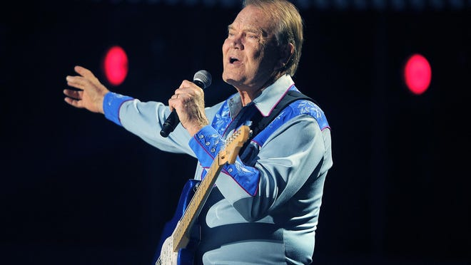 Glen Campbell performs at the 2012 CMA Music Festival. An Aug. 8, 2017, statement on his official website announced his death.
