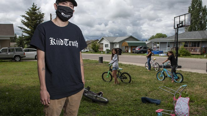 Artie Mendoza III, 25, also known as KiidTruth, looks on outside his home in Pablo, Montana. Mendoza created a dance and song to promote hand washing, mask wearing and social distancing among the youth on the Flathead Indian Reservation.