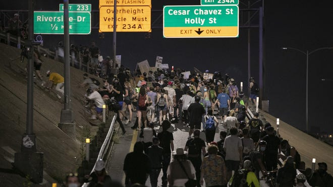 Protesters demonstrating against the killing of George Floyd in Minnesota and Mike Ramos in Austin block Interstate 35 near Austin police headquarters on June 6.