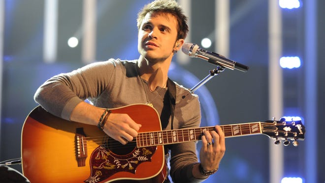 """Amercian Idol,"" finalist  Kris Allen, of Conway, Ark., performs on the program on Tuesday, May 19, 2009, in Los Angeles."
