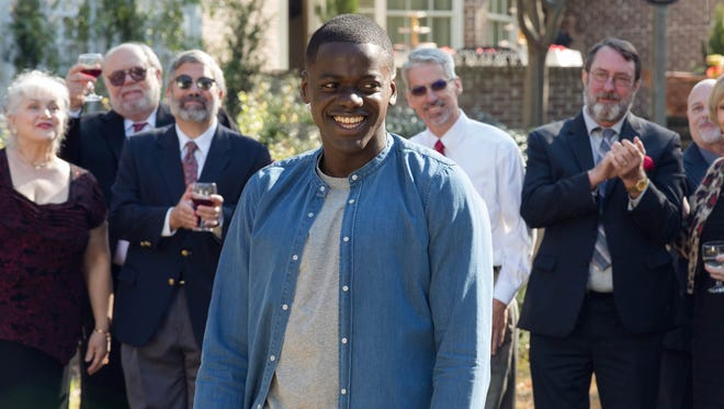 Chris (Daniel Kaluuya) is a guest at a very odd garden party in 'Get Out.'