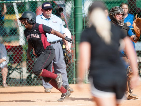 Prattville's Antinique Clay scores on an infield hit
