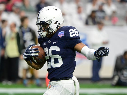 Penn State Nittany Lions running back Saquon Barkley (26) warms up prior to the game against the Washington Huskies during the 2017 Fiesta Bowl at University of Phoenix Stadium.