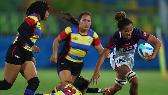 Colombia forward Laura Gonzalez (12) cannot make the tackle on USA forward Nana Faavesi (9) during a rugby sevens match between the USA and Colombia at Deodoro Stadium in the Rio 2016 Summer Olympic Games.