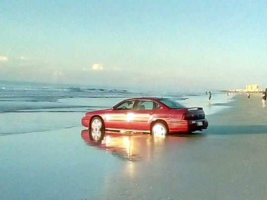 It's not the first time someone has tried to drive onto the Cocoa Beach sand. A man was arrested after getting his car stuck in the sand on Cocoa Beach back in 2017, shown here.