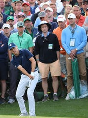 Jordan Spieth chips from the gallery to the 18th green during the first round at the Masters golf tournament Thursday, April 5, 2018, in Augusta, Ga. (Curtis Compton/Atlanta Journal-Constitution via AP)