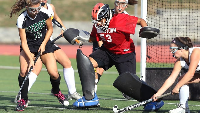 Morristown goalkeeper Gianna Mitchell fights off  Ridge's Laura Pavlosky in a NJSIAA North 1 Group IV semifinal field hockey matchup at Morristown High School. November 2, 2016, Morristown, NJ.