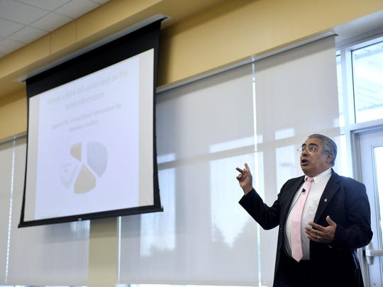 King Banaian, dean of the St. Cloud State University School of Public Affairs, speaks at the St. Cloud Area Quarterly Business Report Review & Regional Outlook on Sept. 17, 2015, in Sauk Rapids.