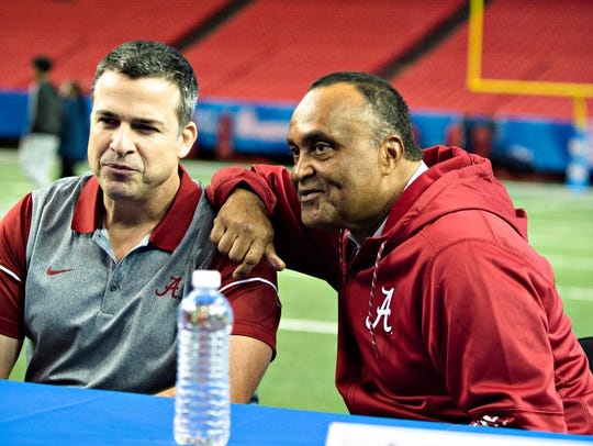 Alabama assistant coach Mario Cristobal, left, and