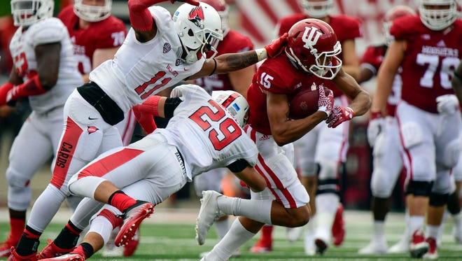 Indiana Hoosiers wide receiver Nick Westbrook (15) evades a tackle from Ball State Cardinals safety Mitch Larsen (29) and Ball State Cardinals cornerback Josh Miller (11) during the during the first half of the game at Memorial Stadium in Bloomington, Ind., on Sept. 10, 2016.