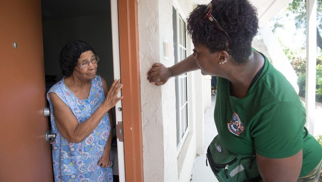"Broward County Community Emergency Response Team member Marie ""Ms. Peaches"" Huntley speaks with Reader Maye Williams while knocking door-to-door in the Sistrunk neighborhood of Fort Lauderdale on Sept. 8, 2017, checking on the needs of elderly and people with special needs before the arrival of Hurricane Irma."