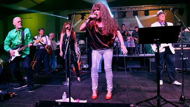 Shannon Roysden sings for the Fabulous Furies during Saturday night's 9th annual Garage Band Woodstock at the Abilene Convention Center.