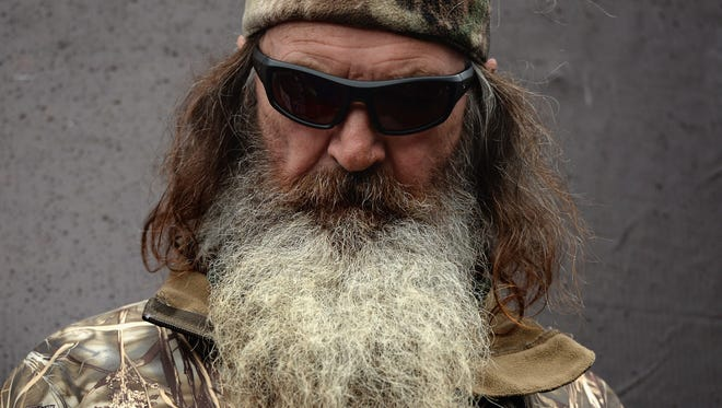 Phil Robertson takes part in pre-race ceremonies for the NASCAR Sprint Cup Series Duck Commander 500 at Texas Motor Speedway on April 6, 2014 in Fort Worth, Texas.